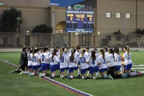The Xavier varsity soccer team celebrates an incredible season.