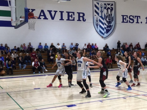 The Xavier Gators take on Red Mountain in an intense game.