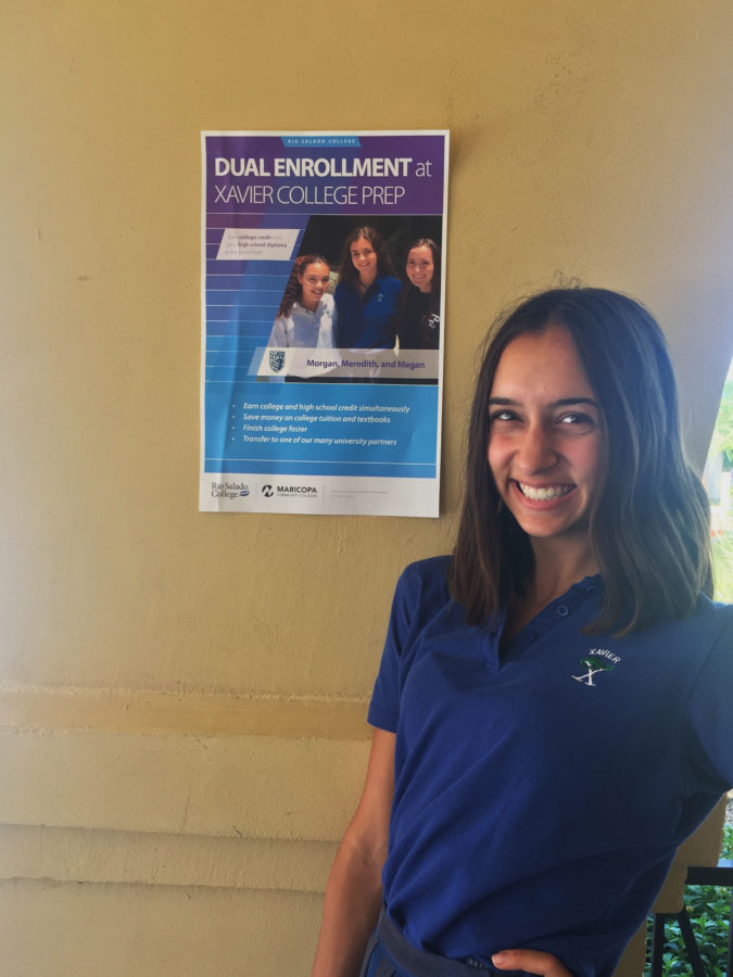 Alex Gburek '17 stands in front of a Rio Salado promotion poster.