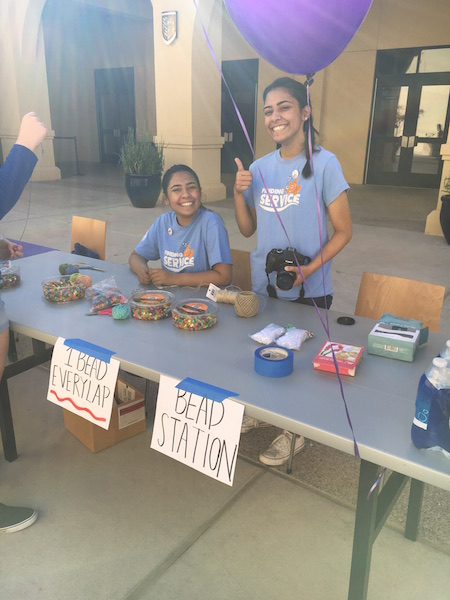 Key+Club+officers+Madeera+and+Saleha+Mian+are+all+smiles+as+they+work+the+Bead+Table.