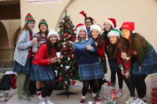 Filled+with+joy+of+the+season%2C+senior+Student+Council+officers+pose+in+front+of+their+tree.+