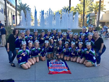 The national champions pose outside of the Anaheim Convention Center.