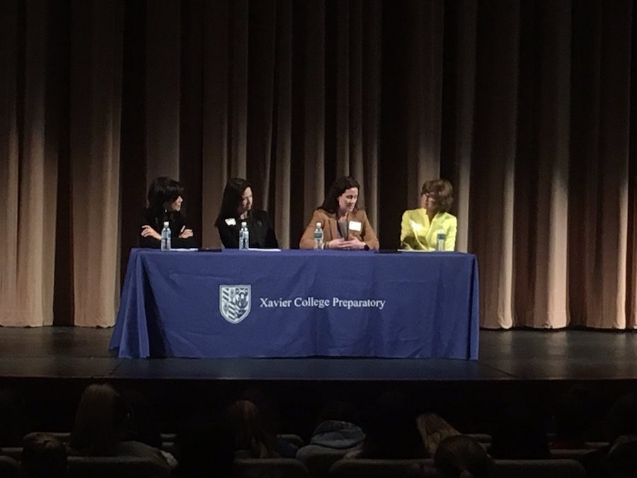 (Left to right) Lin Sue Cooney, Mi-Ai Parrish, Kathryn Hackett King and Judy Mohraz speaking on a panel in the Xavier Performing Arts Center on Friday, March 3, 2017.