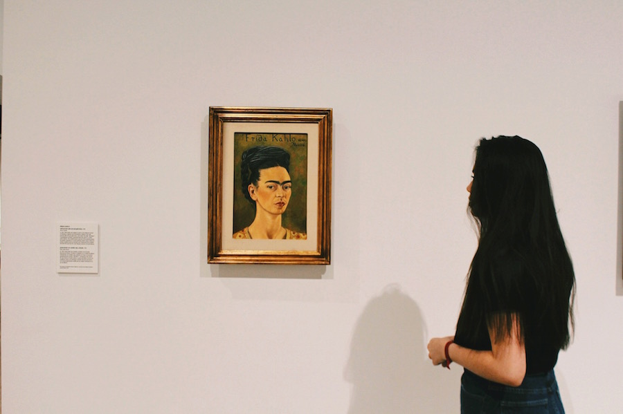 Belen Santistevan '18 looks at one of Frida Kahlo's self-portraits on display in the Heard Museum in Phoenix, Ariz. on Friday, May 19, 2017.