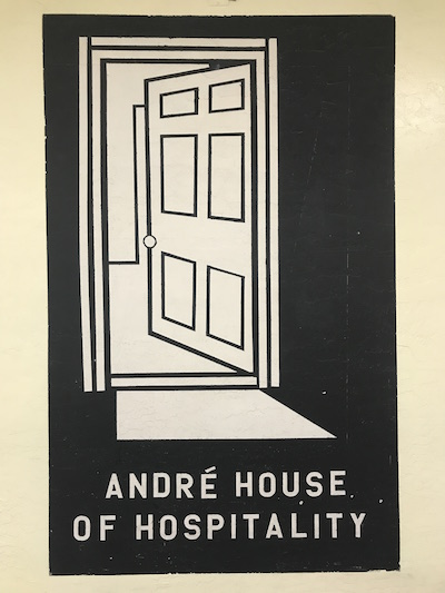 A poster depicting a doorway with text below reading