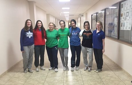 Xavier girls are all smiles on buck-a-sweans day.
