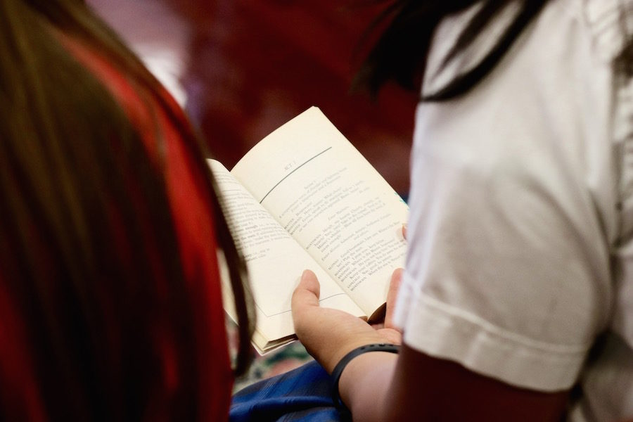 Elie Carlos 18 reads The Tempest by William Shakespeare with Haley Pulliam 18 in the Baldwin Library at Xavier College Preparatory on Tuesday, Oct. 24, 2017.