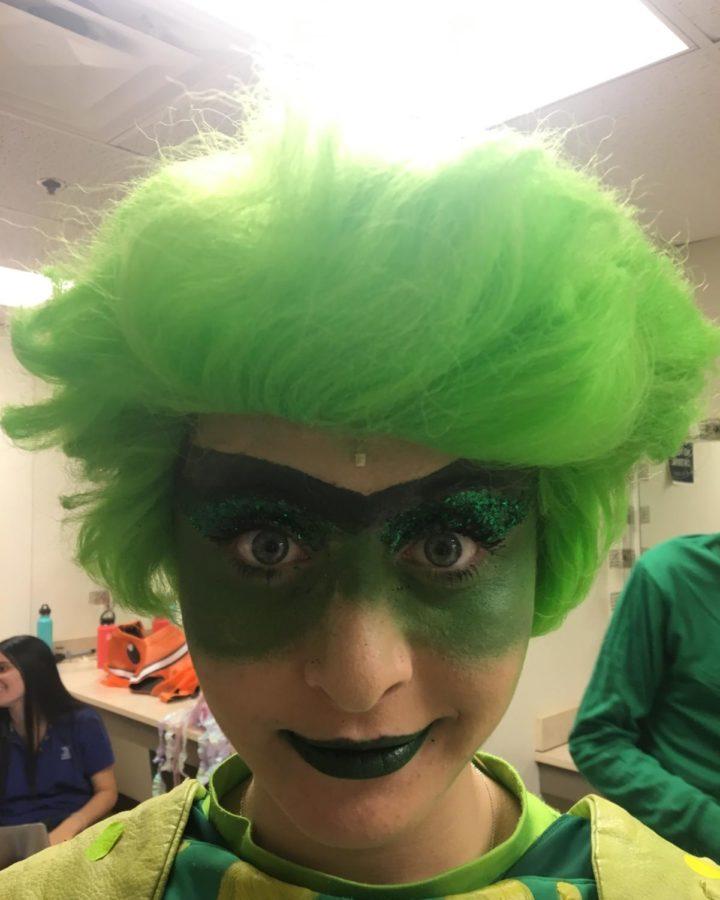 Junior Kate Shein shows off her makeup as Flotsam, Ursula's evil eel companion in