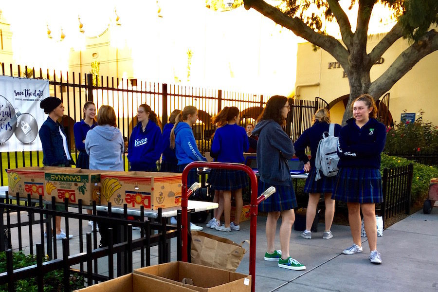 Xavier students donating canned goods and money for the annual food drive at Xavier College Prep on Thursday, Nov. 9, 2017.