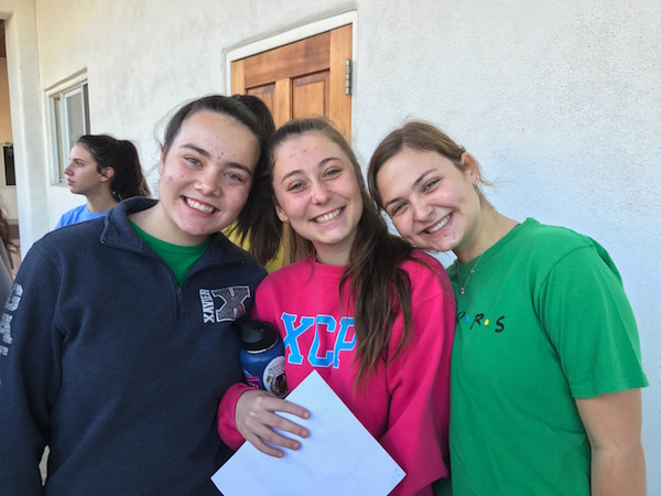 Natalie Vitols (left), Emily Good (middle) and Lily Castle (right) are waiting outside the Mount Claret Retreat Center excited to perform their skit for Student Council.