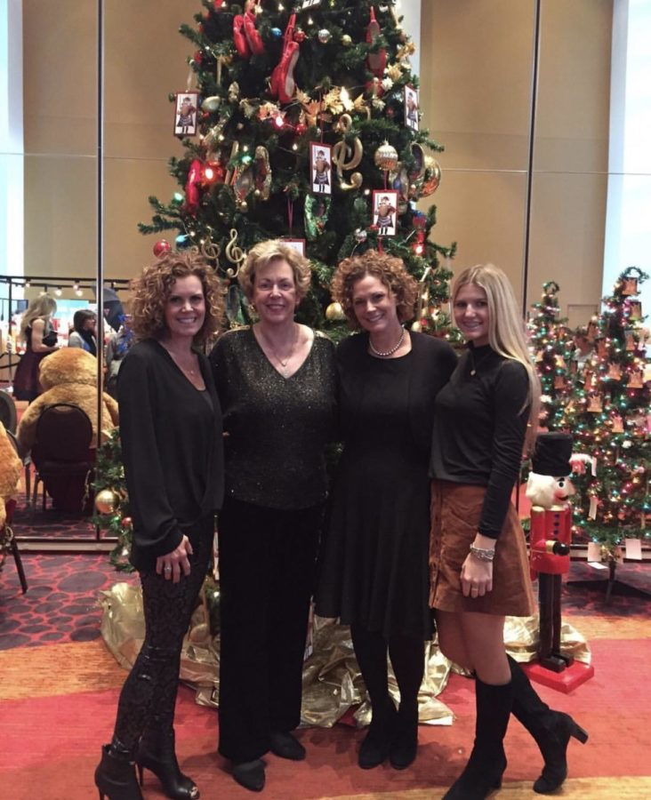 Molly Kuhl with her mom (left), grandma (second left) and aunt Teresa (second to right) enjoying the family Nutcracker tradition.