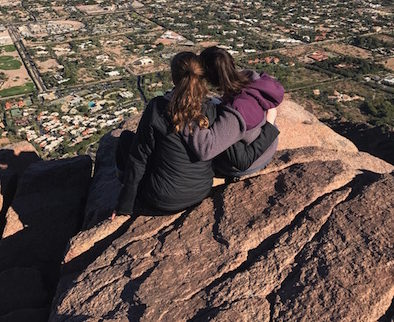 Juniors Marybeth Bonner (left) and Rachel Arabia (right) enjoy the beautiful view and cool weather at the top of Camelback Mountain.