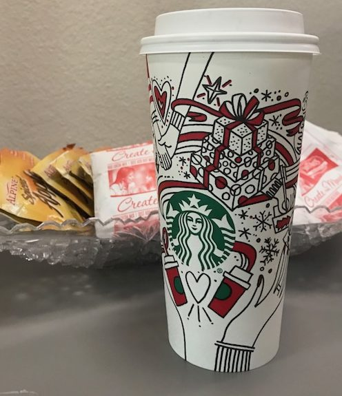 The Starbucks' holiday cup houses peppermint mochas and lattes, but the arguments concerning its design are not as delightful.
