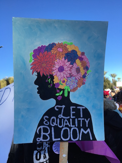 A beautiful poster painted by one of the many young women at the rally.