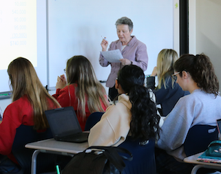 Mrs. Barbra Bond teaches students in the College-Level Accounting class on Feb. 26, 2018.