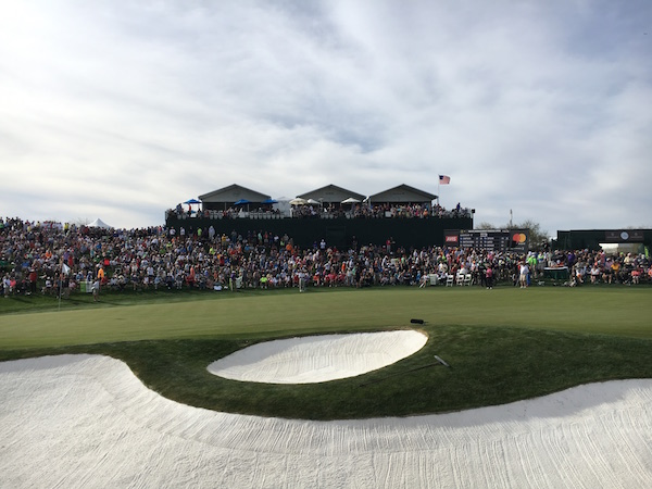 On the 18th hole, thousands of people gathered around, while Thunderbirds directed the golfers.