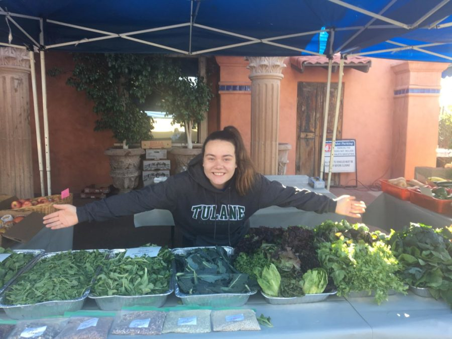 Junior Natalie Vitols selling a variety of produce at the Camelback Market
