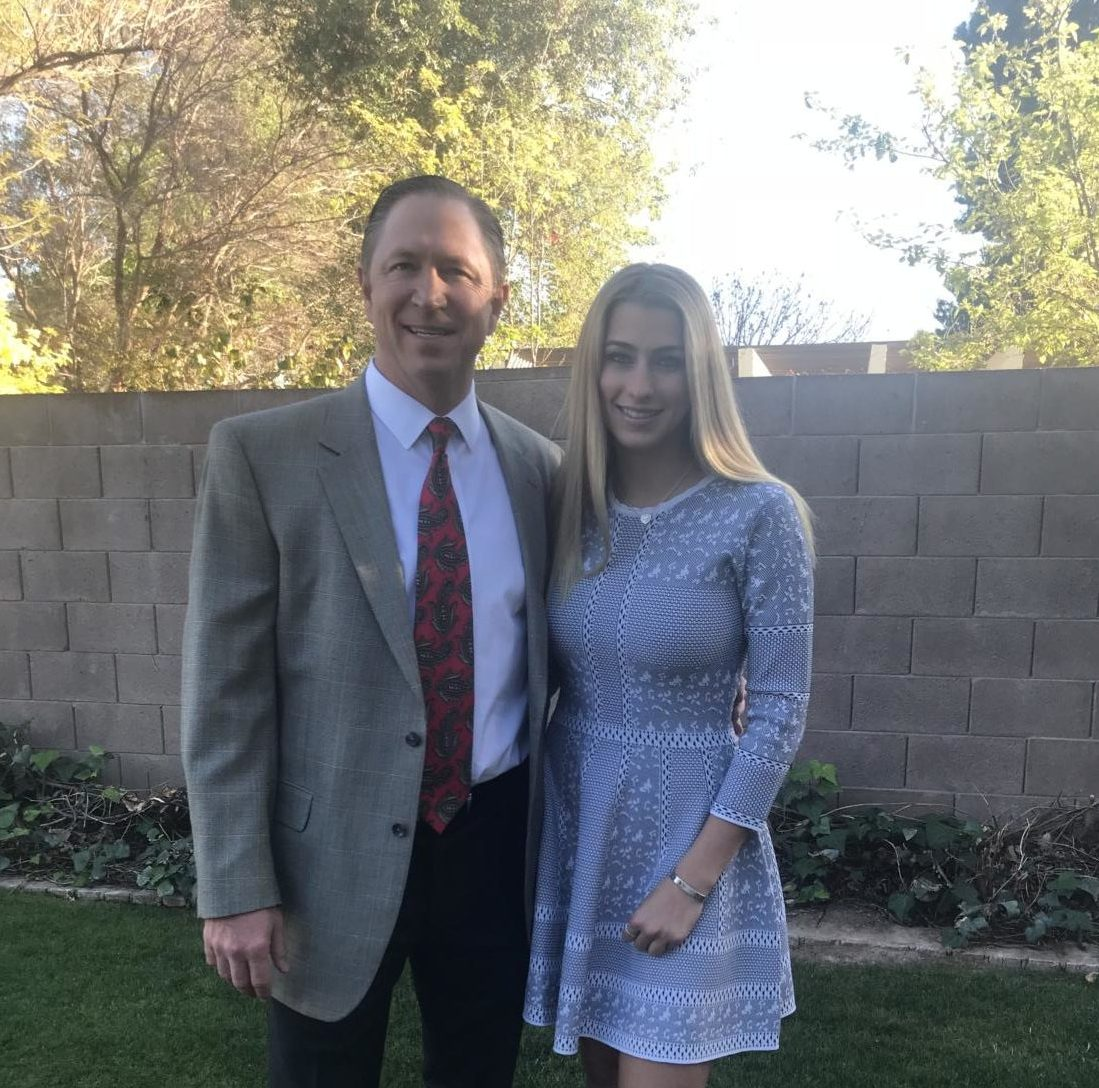 Senior Madelilne Warren and her dad are dressed up to attend the Father-Daughter dance.