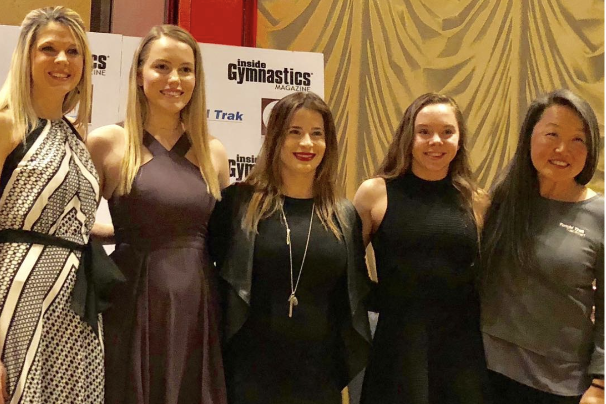 Senior Lauren Stevens beside Inside Gymnastics & Tumbl Trak staff members, 2008 Olympic medalist Alicia Sacramone, and 2-time junior national champion Maile O'Keefe