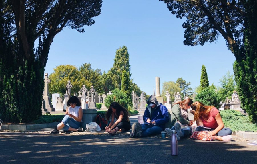 Photos of Inishbofin, Howth, and trip members writing in a Victorian cemetery, courtest of Emmegale East, '19.