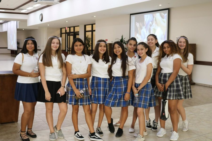 Eighth+graders+pose+for+a+picture+during+lunch+time.