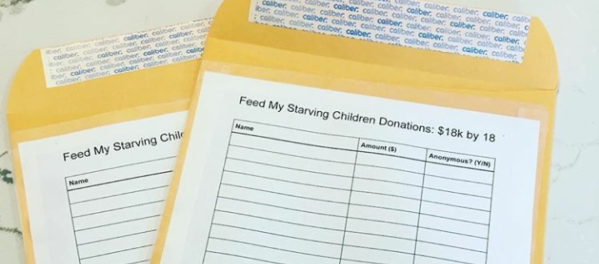 Andie Ziltzer '19 uses these two packets to collect donations for Feed My Starving Children outside of Founders Hall. On the front, the packets ask you to write your name, the amount you gave, and if you want your name to remain anonymous.