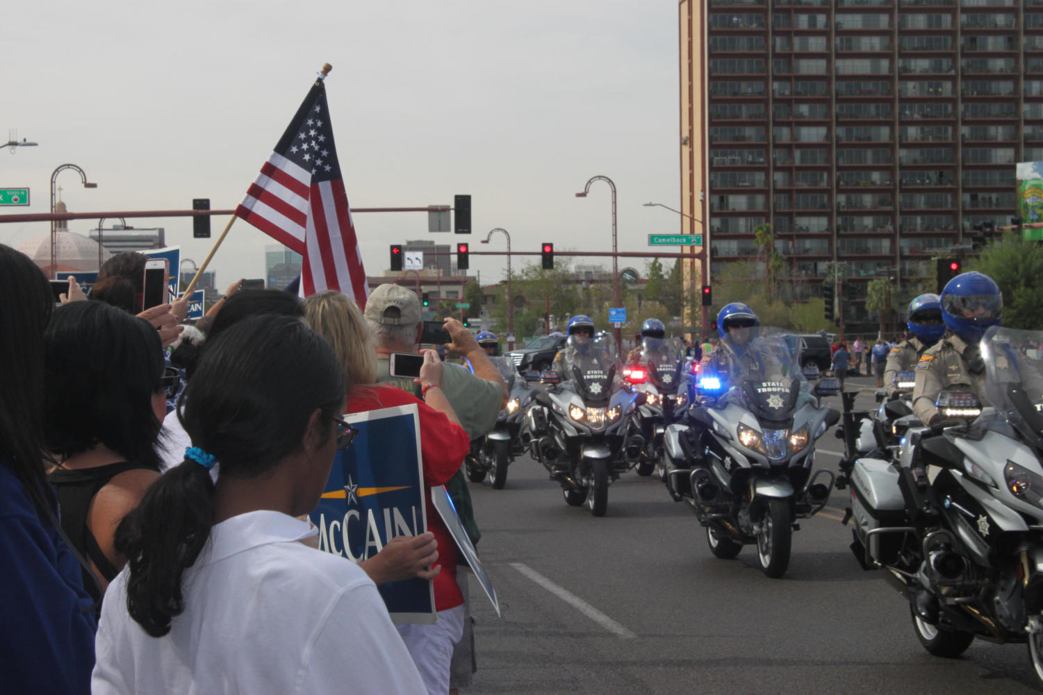 Phoenix PD escorts the McCain family down Central Avenue.
