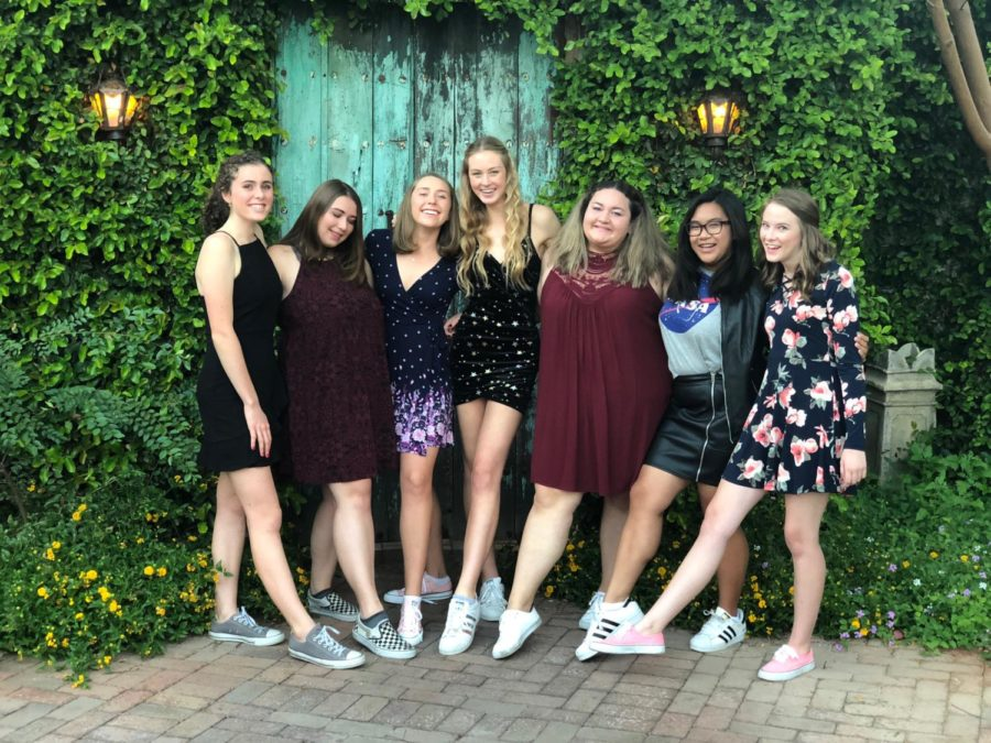 Friends pose for Homecoming in modern styles