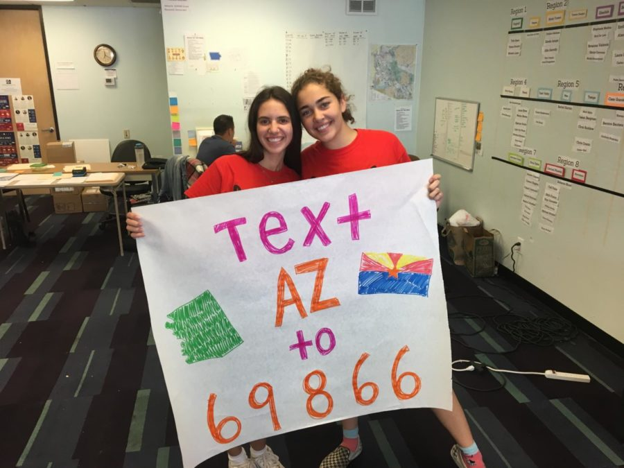 Democratic Headquarters volunteers, Maddie Dinowitz and Mackenzie Bouis '19, pose with a handmade sign for the campaign effort. Photo courtesy of Maddie Dinowitz.