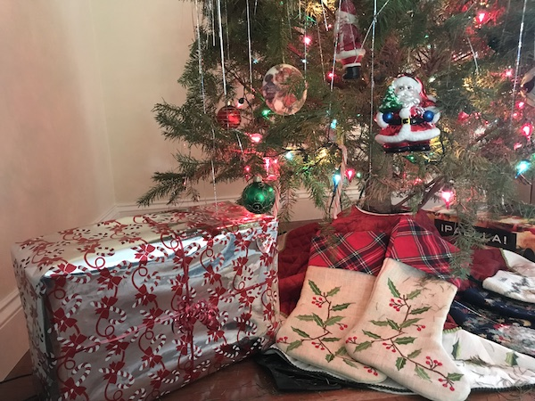 Holiday presents and stockings rest under the tree with plenty of time until Christmas.