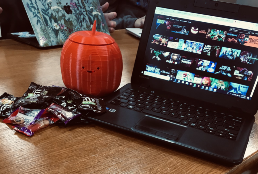 A+photo+of+the+Halloween+section+of+Netflix+along+with+a+pile+of+various+candies.+