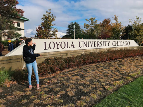 Sienna Martinez '21, stands in front of Loyola University Chicago sign on Friday, Nov. 2, 2018.