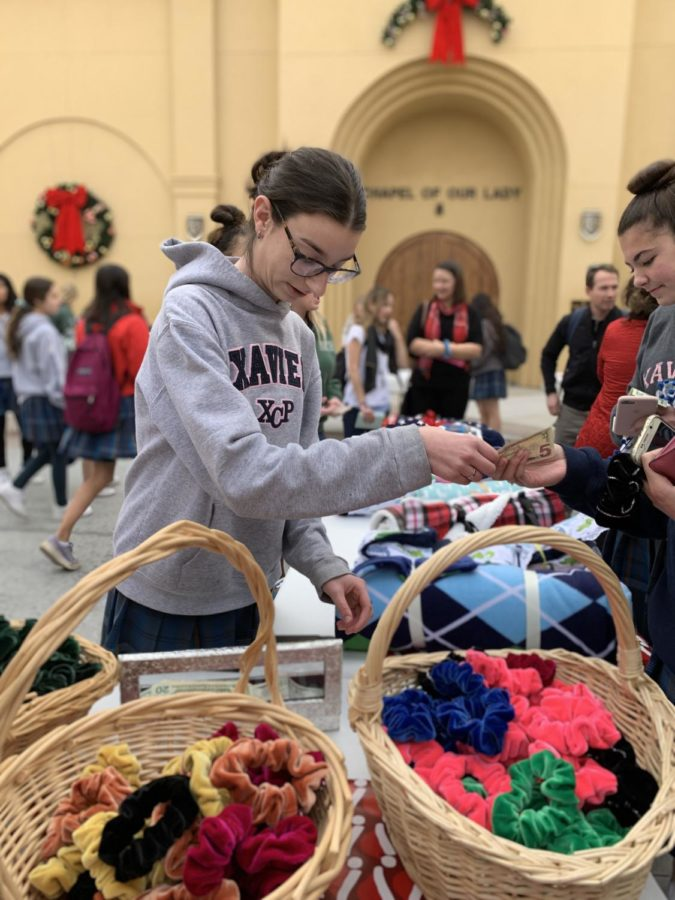Xavier students buying and selling everyone's favorite, scrunchies.