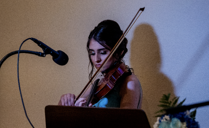 Xavier junior Edyta Zimny playing the violin. Photo by Tobias Ogden of Image in Love Photography.