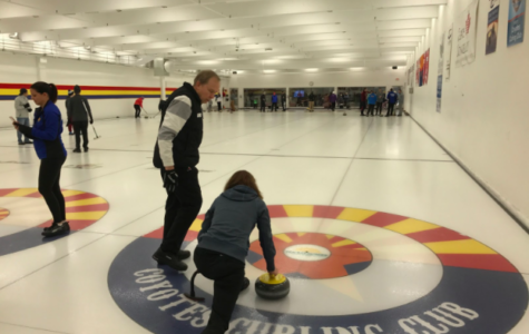 Senior Helen Innes' parents try a new curling class. They wanted to try something new for the New Year, so they signed themselves up for an introductory course.
