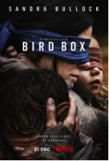 Sandra Bullock as her character Malorie in the Netflix film Birdbox. She is blindfolded holding her two children, Boy and Girl.