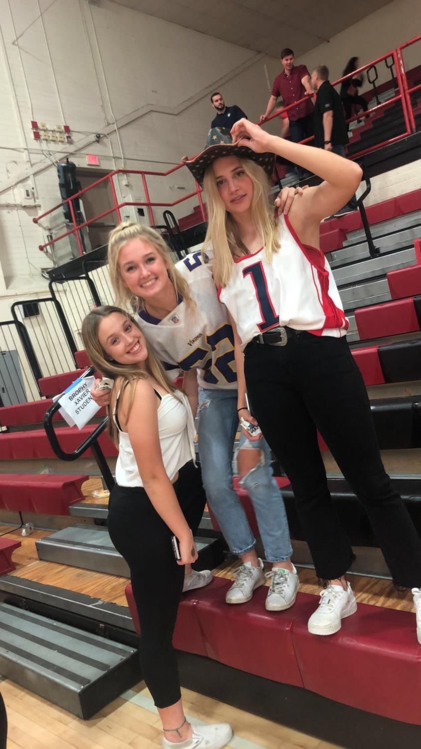 Junior Megan Onofrei, Senior Lindsay Hubbard, and Senior Sadie Wintergalen enjoyed the atmosphere of the Brophy Hoopcoming Basketball Game. Although the Broncos came up short in the game this year, Hoopcoming was a fun time for all.