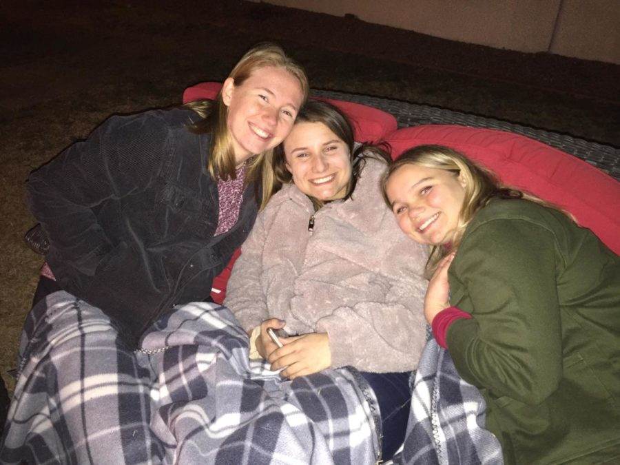 Seniors Maddie Wickers, Clare Carlsonn, and Abbey Alexander snuggle up for a movie night.