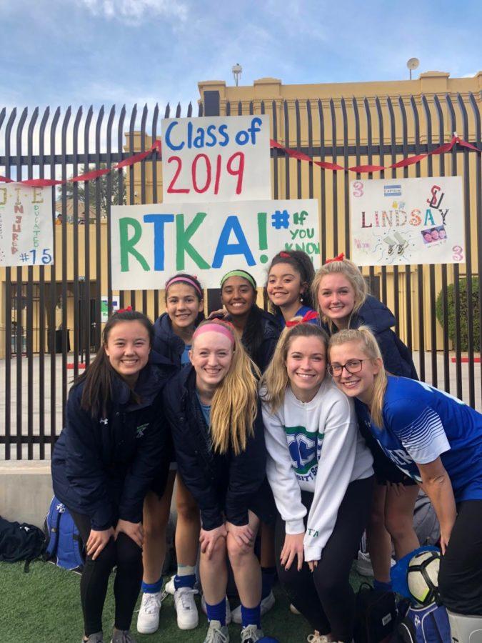 Seniors Caitlin Johnson, Sadie Wintergalen, Emily Chiao, Lindsay Hubbard, Katie McGee and Allie Broderick, Karla Alvarado, and Kelli Rasmussen pose pre-game.
