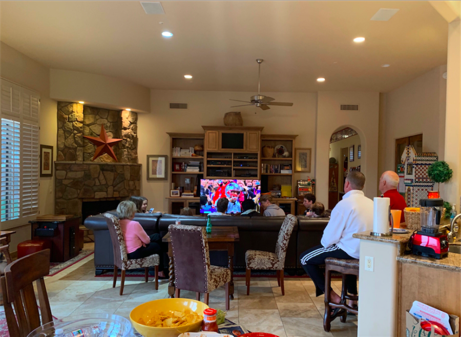 Brophy and Xavier students gather to watch Super Bowl LIII on Sunday Feb 3. Food was provided on the table, while the game was going on. As well as a friendly betting board located to the far right of the image. Photo Courtesy of Junior Sophia Salome.