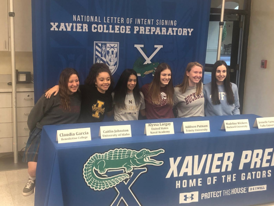 On+Feb.+6%2C+six+Xavier+seniors+signed+National+Letters+of+Intent+to+play+collegiate+sports.+The+Xavier+community+is+so+proud+and+cannot+wait+to+see+what+these+ladies+will+accomplish+in+college%21+Photo+courtesy+of+Caitlin+Johnston+%E2%80%9819.%0A