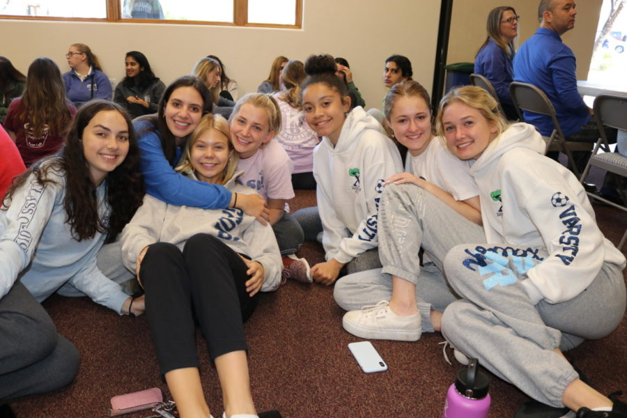 Seniors get cozy in their sweans for their final Prayer Day