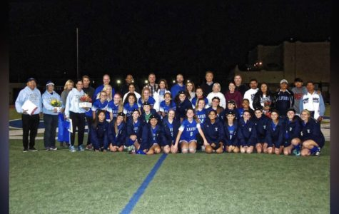 Pictured is the entire varsity soccer team from this season on senior night. The parents of the seniors and the coaches are also in the picture. Photo Courtesy of Megan Onofrei