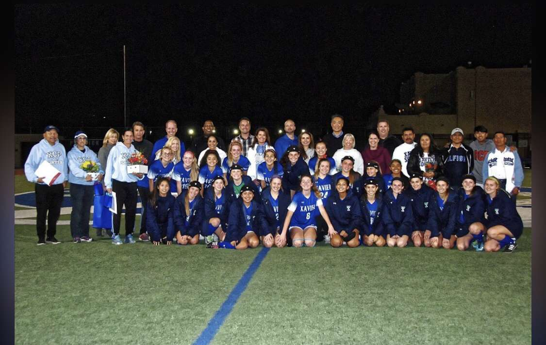 Pictured is the entire varsity soccer team from this season on senior night. The parents of the seniors and the coaches are also in the picture. Photo Courtesy of Megan Onofrei '20.