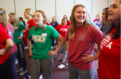 Taylor Garman '20, Emma Elsbecker '20, and Angelina Abdeen '20 giggle while embracing the lighthearted nature of Senior Prayer Day. This picture was taken during Activity A with Ms. Cavnar as the girls did a warm up activity to become even more familiar with their peers. Photo Courtesy of Meghan Galbreath '20.