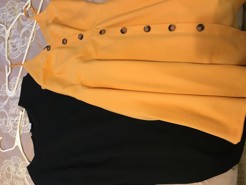 A photo of two modest dresses in Mia Parham's closet.  Photo credit: Mia Parham '20.