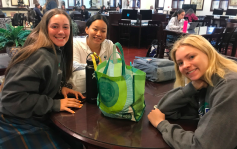 Sophomores Meghan Shouten, Sharon Cardenas, and Nina McFarland wait in the library until their shadows get dropped off.  Photo credit: Caroline Hink '20.
