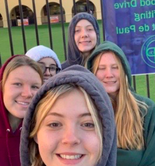 NHS members volunteer in the morning on Thursday, November 5th, 2019 for the Can Food Drive at Xavier College Preparatory in Bidwells Circle. Photo Credit: Brianna Butkiewicz