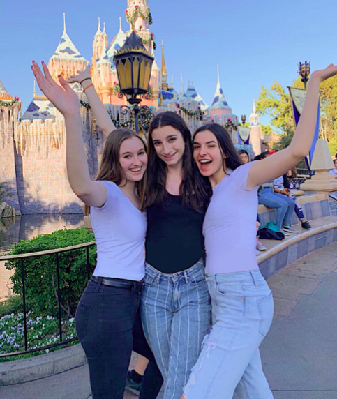 Juniors Emma McCarthy, Sloan Sciarappo, and Simone La Magna (left to right) in front of Sleeping Beauty's Castle at Disneyland on November 9!  Photo Credit: Simone La Magna '21