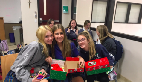 Members of the Key Club gathered after school to pack boxes for Operation Christmas Child Photo Credit: Mrs. Alison Mead